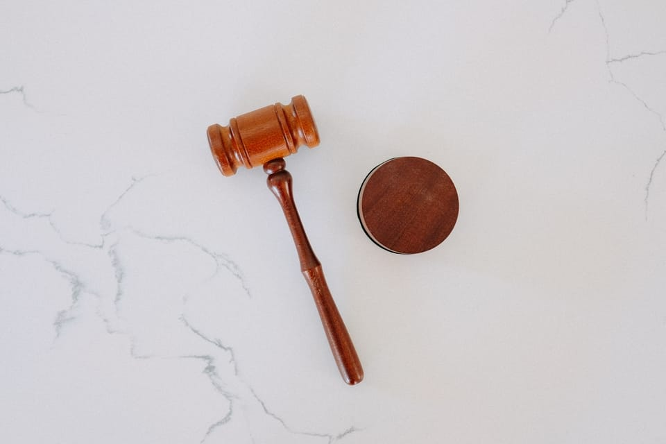 brown-gavel-on-marble-surface