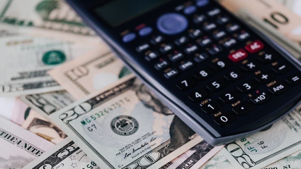 calculator-on-cash-money